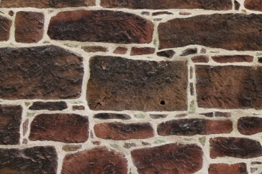 After repointing - many of the pinning stones carefully replaced to match the original aesthetic and to maintain a joint size of less than 1/2''